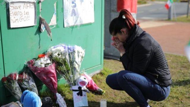 A woman grieves outside Alder Hey Hospital