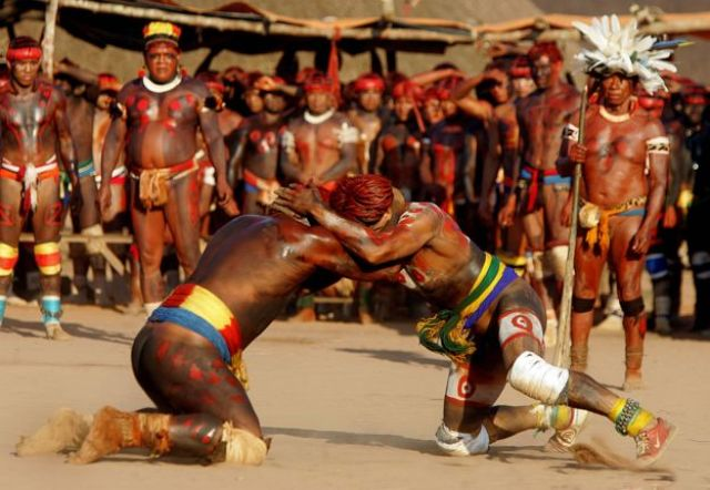 Brazilian Indian warriors of the Yawalapiti (L) and Kuikuro tribes engage in a fight as part of the Kuarup ceremony, in an area of the Amazon forest occupied by the Awara tribe, in central Brazil, 14 August 2005.
