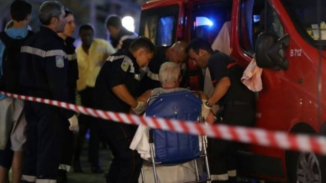 Emergency workers help an injured woman in Nice