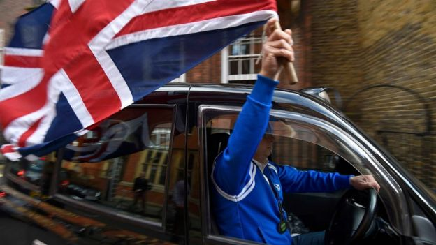 Taxi driver waves Union Flag