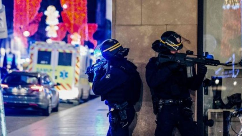 French police stand guard near the scene of a shooting in Strasbourg, eastern France, 11 December 2018