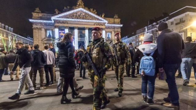 Soldiers patrol as people see in the New Year in the historic centre of Brussels. The New Year's Eve fireworks display and all official events were cancelled in Belgium's capital