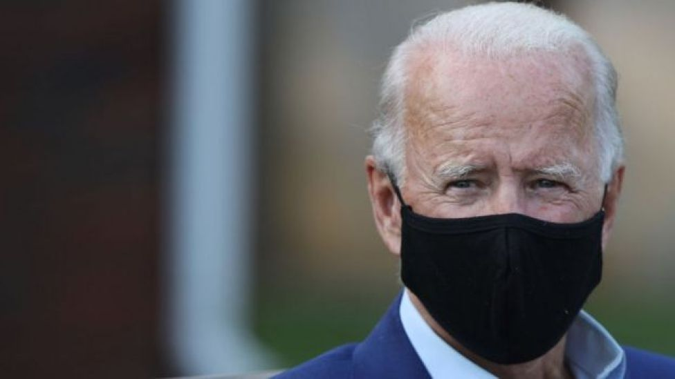 Joe Biden wearing black face mask