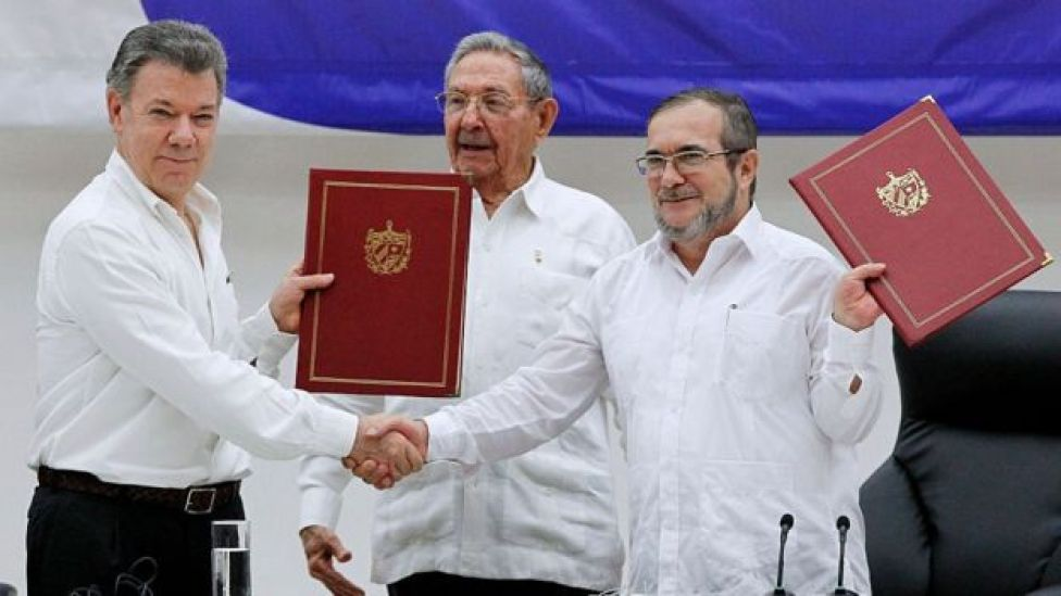 Juan Manuel Santos president of Colombia (L) and Timoleon Jimenez 'Timochenko' (R) shake hands during a ceremony to sign a historic ceasefire agreement between Colombian Government and the Farc rebels to end a 50-year conflict on June 23, 2016 in Havana, Cuba