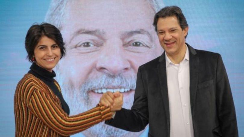 Manuela D'Ávila (esq.) e Fernando Haddad (dir.) em debate paralelo