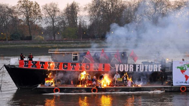 A boat with burning memorabilia on the river thames