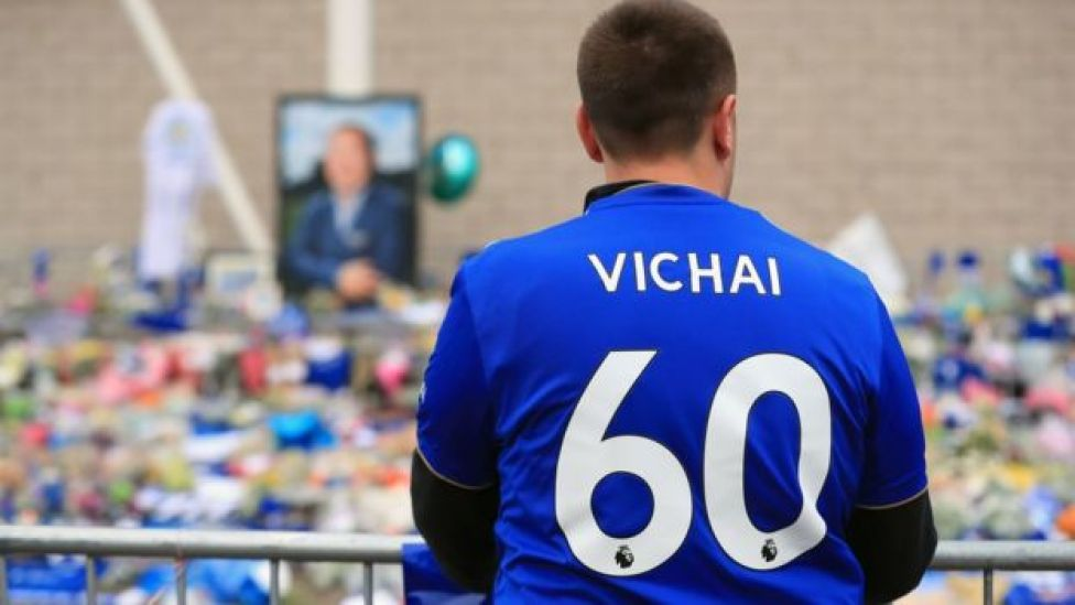 Leicester City fan looks over tributes in Vichai shirt