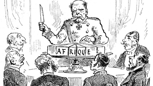 """French commentary on the Berlin Conference of 1884-1885: Otto von Bismarck, then Chancellor or Germany, is portrayed here wielding a knife over a sliced-up cake, labelled """"Africa"""". His fellow delegates around the table look on in awe."""