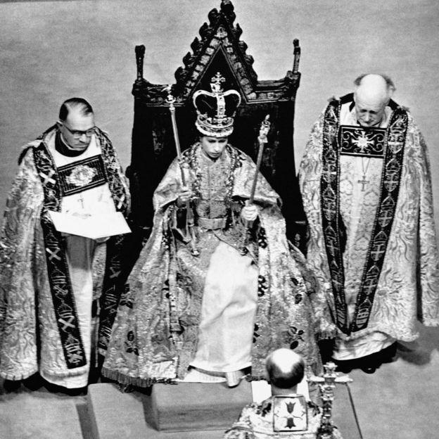 After the coronation in Westminster Abbey, London, Queen Elizabeth II is seen wearing the St Edward's Crown.