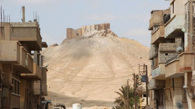 A picture taken on March 27, 2016, shows the citadel of the ancient city of Palmyra as seen from a residential neighbourhood of the modern town after Syrian troops recaptured the city from the Islamic State (IS) group.