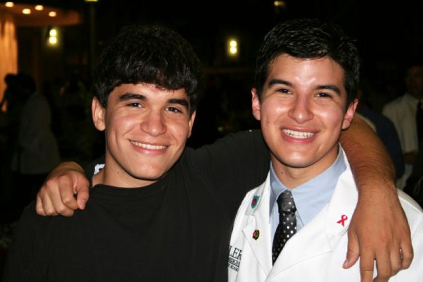 Salinas, pictured with his brother, during his medical training