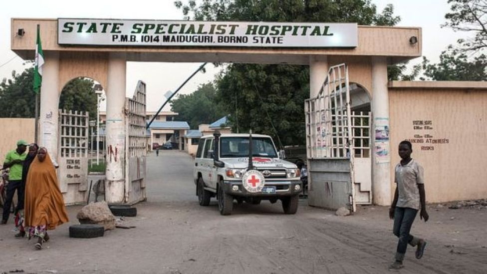 A Red Cross vehicle leaves the Maiduguri State Specialist Hospital grounds