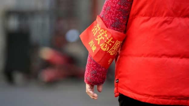 A close up shot of a Beijing resident's red armband, identifying her as security volunteer, in Beijing, China, 2 March 2017.