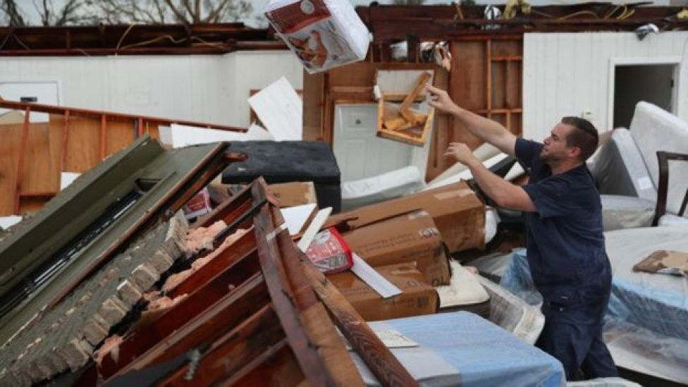 A man salvages what he can from his store in Lake Charles