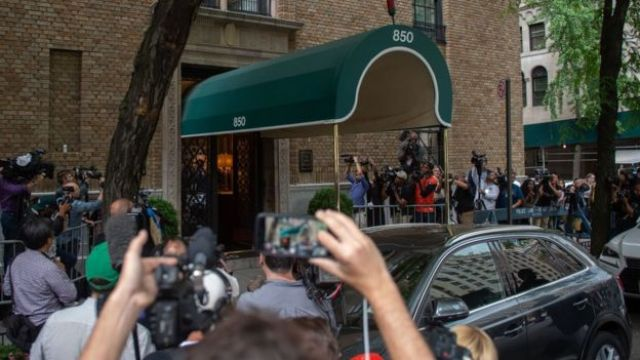 Press gather outside the apartment of Kate Spade on 5 June 2018