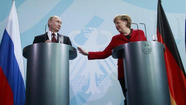 Putin and Merkel at a press conference