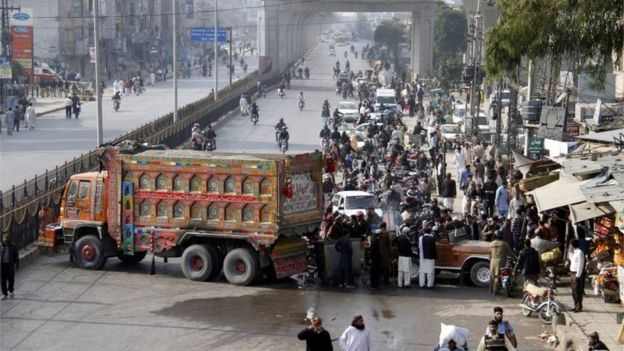 Protesters block a road linking to Islamabad, to protest at the execution of former police guard Mumtaz Qadri, after he was hanged in Rawalpindi, Pakistan, 29 February 2016.