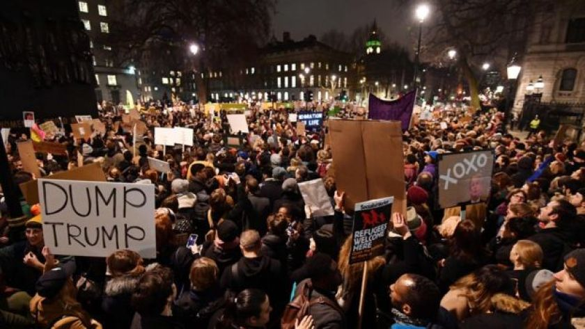 Demonstrators protest outside Downing Street against US President Donald Trump in central London on January 30, 201