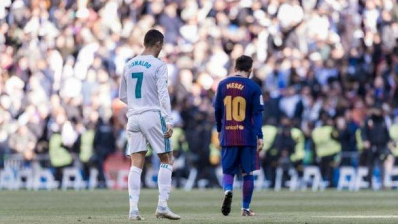 Messi e Ronaldo com uniforme de seus times na Espanha