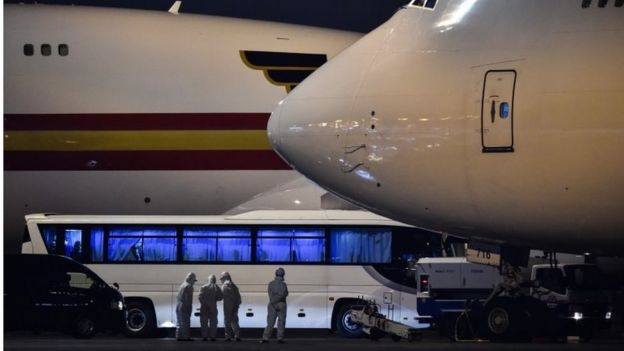 Aircraft wait to take Americans home from Japan after they were taken off the quarantined cruise ship, Diamond Princess, 17 February 2020