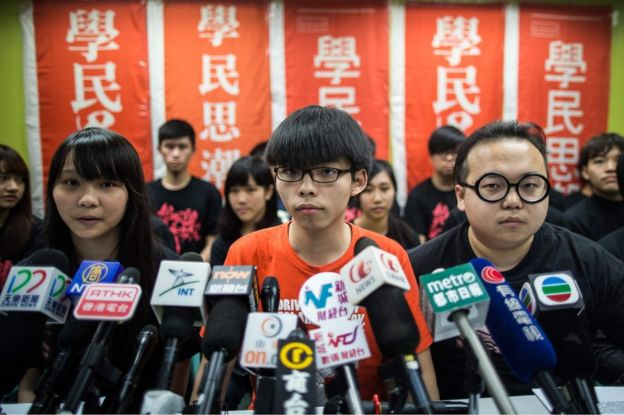 Student protester Joshua Wong (C), 19, and other members of pro-democracy campaign group Scholarism look on at the start of a press conference regarding the group's future plans, in Hong Kong on 20 March 2016