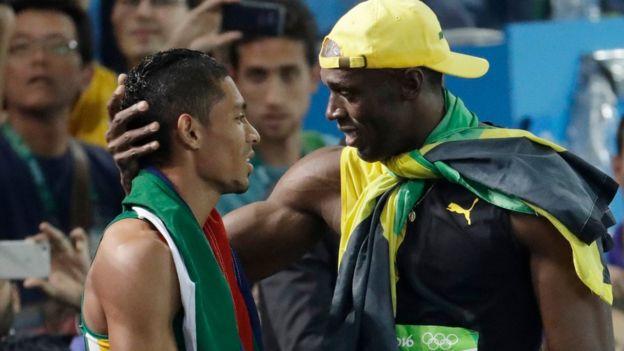 Jamaica's Usain Bolt (R) congratulates South Africa's Wayde van Niekerk - 14 August 2016