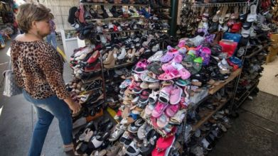 A woman shops for Chinese made shoes at a store in the Chinatown area of Los Angeles, California on August 24, 2019