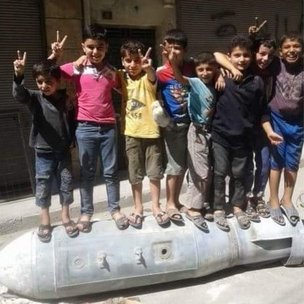 picture of children standing on a bomb