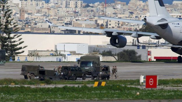 Maltese troops survey a hijacked Libyan Afriqiyah Airways Airbus A320