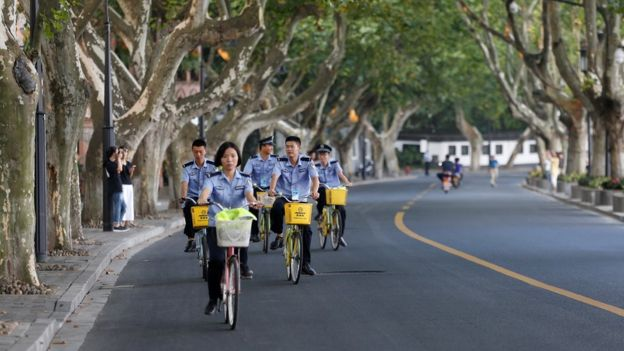 Security personnel ride bicycles on an empty road near the West Lake, as police closed off many roads before G20 Summit in Hangzhou, Zhejiang Province, China 31 August 2016.