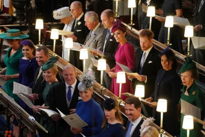 "Queen Elizabeth II, the Duke of Edinburgh, the Prince of Wales, the Duke of Cambridge, the Duchess of Cambridge, the Duke of Sussex, the Duchess of Sussex and the Princess Royal, (left to right front row) Sarah Ferguson, Princess Beatrice, Peter Phillips, Autumn Phillips, Mike Tindall, Zara Tindall, Lady Louise Mountbatten-Windsor and Crown Prince Pavlos of Greece at the wedding of Princess Eugenie to Jack Brooksbank at St George""s Chapel in Windsor Castle"