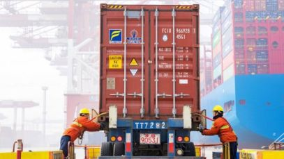 Workers prepare a container at a Chinese port in 2019