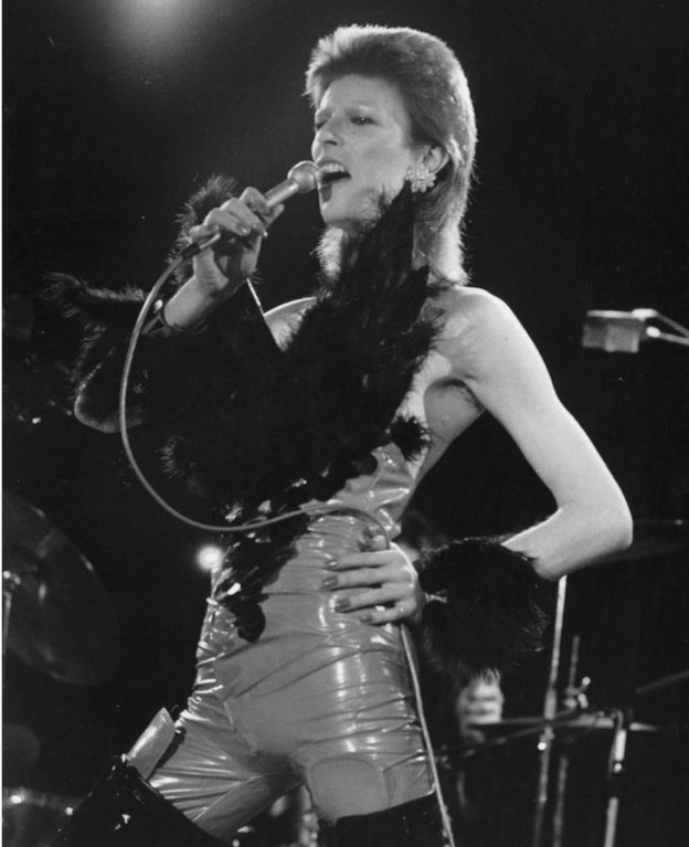 David Bowie performing in his 'Angel of Death' costume at a live recording for a Midnight Special TV show made at The Marquee Club in London to a specially invited audience of Bowie fanclub members in 1973