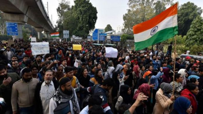 Demonstrators during a protest against the Citizenship Amendment Act (CAA), near Jamia Millia Islamia on December 15, 2019 in New Delhi, India
