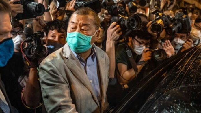 Jimmy Lai leaving police station last month