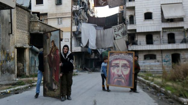 Christians carrying religious paintings in Aleppo