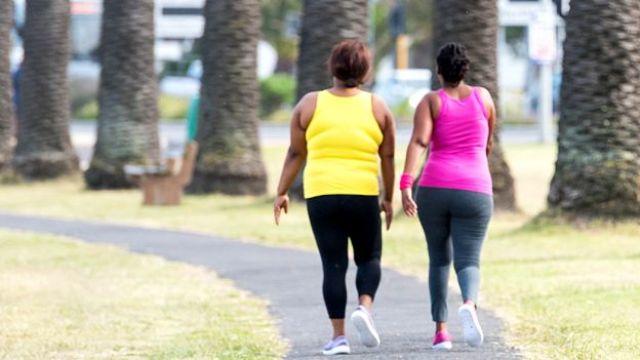Two women walking in South Africa