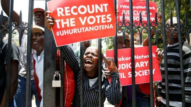 Mr Kenyatta's supporters protest outside the country's Supreme Court, 19 September 2017