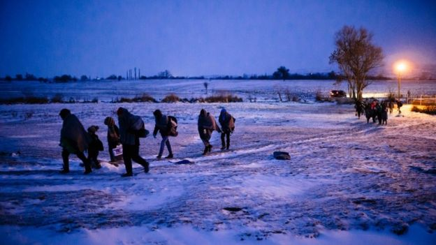Refugees cross the Macedonian border into Serbia, 17 January