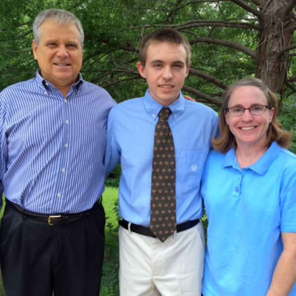 Jim, his son and his wife, at his son's graduation