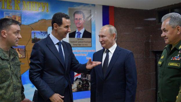 Syrian President Bashar al-Assad talks to Russian President Vladimir Putin in Damascus, Syria (7 January 2020)