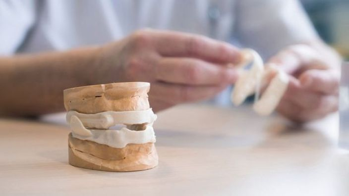 Mandibular advancement braces being handled by an ENT surgeon