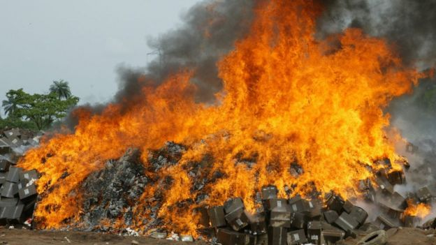 This file picture taken on November 1, 2007 at Shagamu dump site in Ogun State, southwest Nigeria shows seized cartons of fake drugs set ablaze by officials of the National Agency for Food and Drug Administration and Control