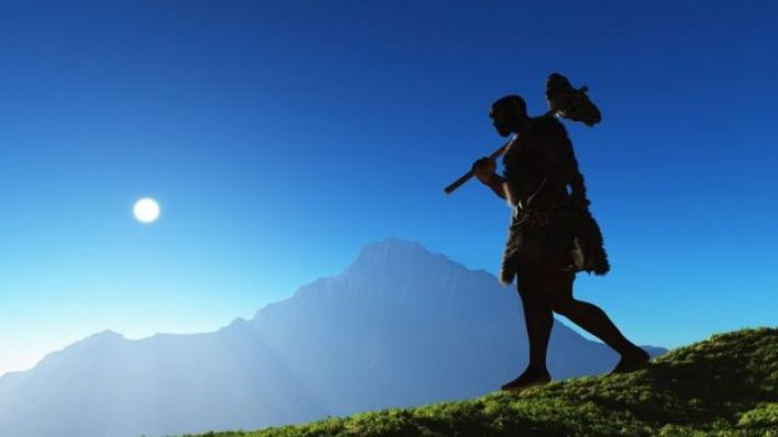 صورة توضيحية: إنسان بدائي يمشي في منظر طبيعي بدائي