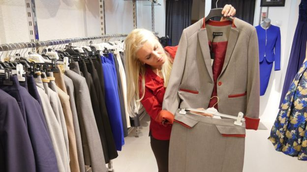 Elda Morina, owner of the Hillary boutique, shows off an outfit in her collection