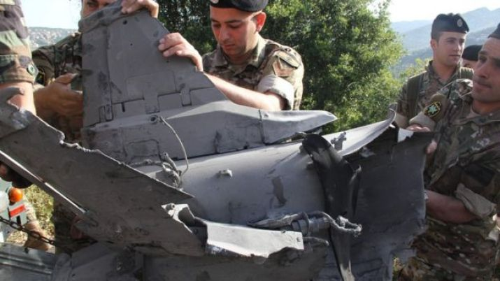 Lebanese soldiers inspect remains of a surface to air missile that landed in the southern Lebanese village of Hebarieh, early on May 10, 2018.