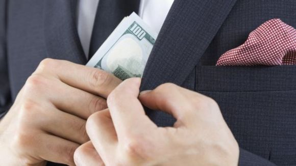 A man removing money from his jacket