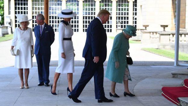 Donald Trump walks into Buckingham Palace