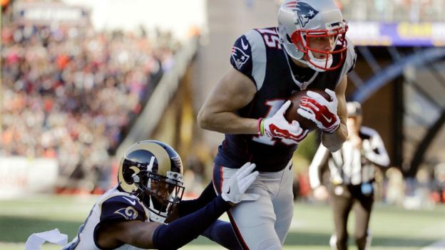 New England Patriots wide receiver Chris Hogan (15) catches a pass for a touchdown against Los Angeles Rams cornerback E.J. Gaines (33) during the first half of an NFL football game, Sunday, Dec. 4, 2016
