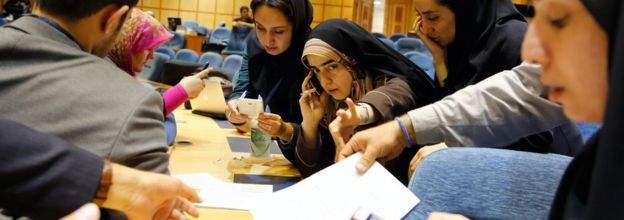 Iranian journalists follow the preliminary results of parliamentary and Experts Assembly elections at the Interior Ministry, in Tehran, Iran, 28 February 2016